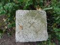 Kamenný triangulační bod na Číčovickém Kamýku.