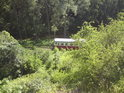 Pohled shora přes lom na trať s romantickým vláčkem a říčku Výrovku.